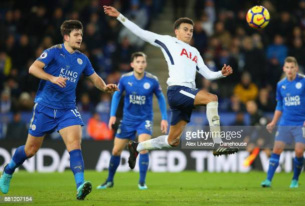 Dele Alli of Tottenham Hotspur controls the ball ahead of Harry Maguire of Leicester City during the Premier League match between Leicester City and...
