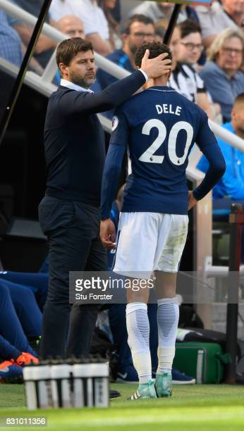 Dele Alli of Tottenham Hotspur embraces with Mauricio Pochettino Manager of Tottenham Hotspur after he is subbed during the Premier League match...