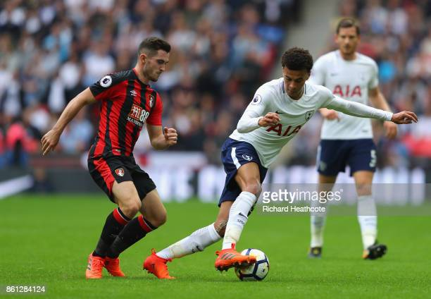 Dele Alli of Tottenham Hotspur evades Lewis Cook of AFC Bournemouth during the Premier League match between Tottenham Hotspur and AFC Bournemouth at...