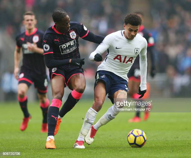 Dele Alli of Tottenham Hotspur evades Terence Kongolo of Huddersfield Town during the Premier League match between Tottenham Hotspur and Huddersfield...