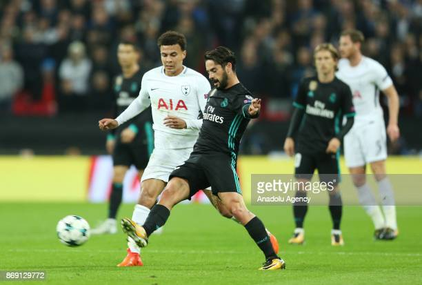 Dele Alli of Tottenham Hotspur FC in action against Isco of Real Madrid during the UEFA Champions League Group H soccer match between Tottenham...