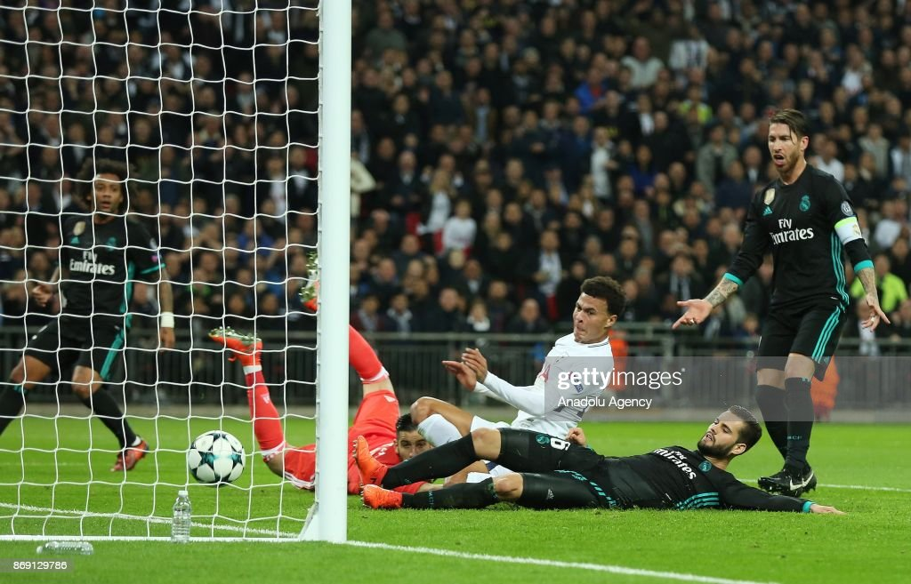 Dele Alli (C) of Tottenham Hotspur FC shoots to score during the UEFA Champions League Group H soccer match between Tottenham Hotspur FC and Real Madrid at Wembley Stadium in London, United Kingdom on November 01, 2017.