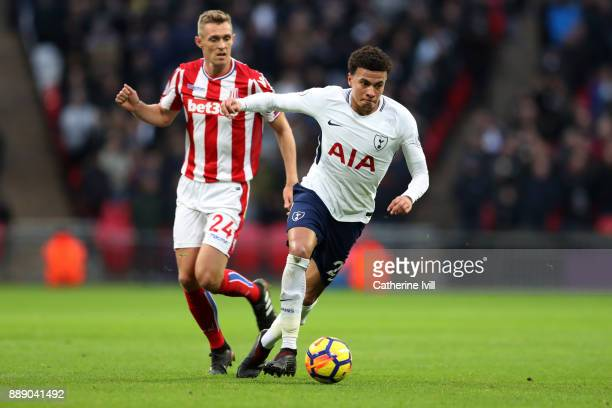 Dele Alli of Tottenham Hotspur gets away from Darren Fletcher of Stoke City during the Premier League match between Tottenham Hotspur and Stoke City...