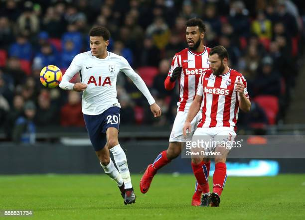 Dele Alli of Tottenham Hotspur gets away from Erik Pieters of Stoke City during the Premier League match between Tottenham Hotspur and Stoke City at...