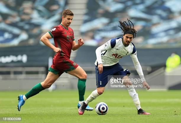 Dele Alli of Tottenham Hotspur gets past Leander Dendoncker of Wolverhampton Wanderers during the Premier League match between Tottenham Hotspur and...