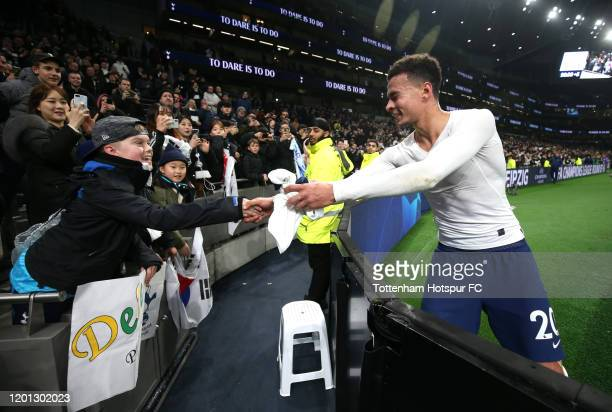 Dele Alli of Tottenham Hotspur gives his shirt to a young fan after the Premier League match between Tottenham Hotspur and Norwich City at Tottenham...