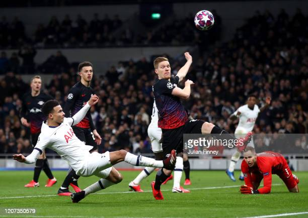 Dele Alli of Tottenham Hotspur goes close under pressure from Marcel Halstenberg of RB Leipzig during the UEFA Champions League round of 16 first leg...