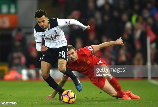 Dele Alli of Tottenham Hotspur goes past Jordan Henderson of Liverpool during the Premier League match between Liverpool and Tottenham Hotspur at...