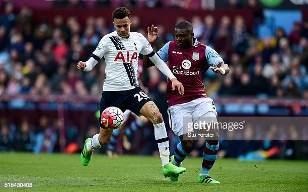 Dele Alli of Tottenham Hotspur holds off Jores Okore of Aston Villa during the Barclays Premier League match between Aston Villa and Tottenham...