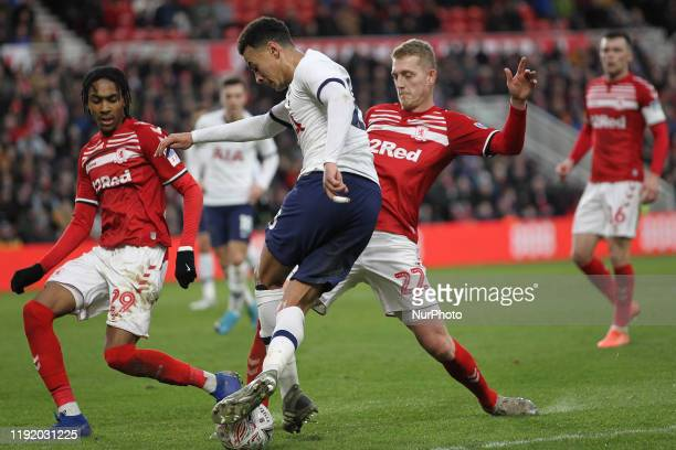Dele Alli of Tottenham Hotspur in action with Djed Spence and George Saville during the FA Cup Third Round match between Middlesbrough and Tottenham...