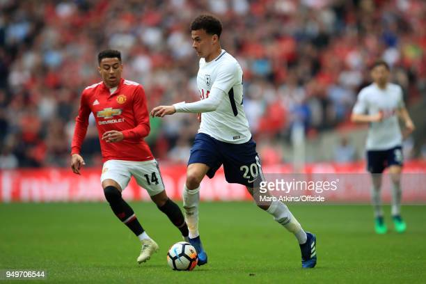 Dele Alli of Tottenham Hotspur in action with Jesse Lingard of Manchester United during the Emirates FA Cup Semi Final at Wembley Stadium between...