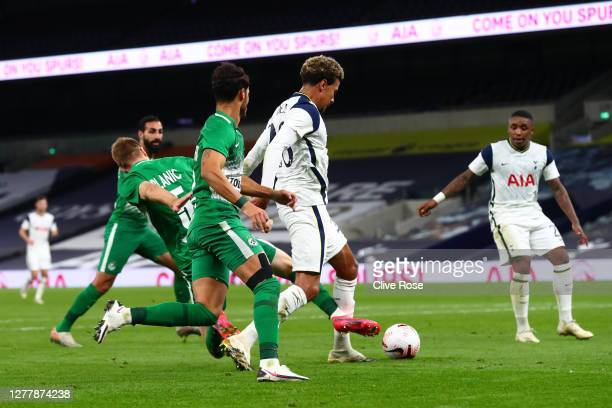 Dele Alli of Tottenham Hotspur is brought down in the penalty area which leads to a penalty being awarded and Dele Alli of Tottenham Hotspur scoring...