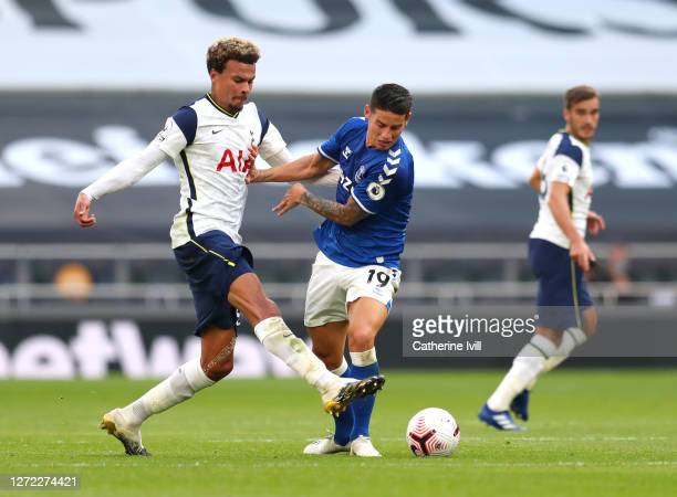 Dele Alli of Tottenham Hotspur is challenged by James Rodriguez of Everton during the Premier League match between Tottenham Hotspur and Everton at...