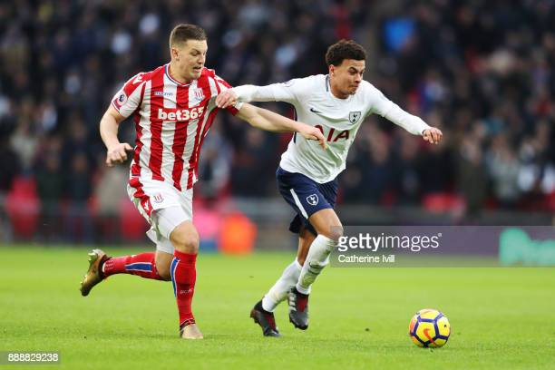 Dele Alli of Tottenham Hotspur is challenged by Kevin Wimmer of Stoke City during the Premier League match between Tottenham Hotspur and Stoke City...