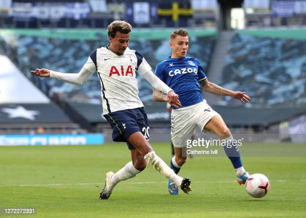 Dele Alli of Tottenham Hotspur is challenged by Lucas Digne of Everton during the Premier League match between Tottenham Hotspur and Everton at...