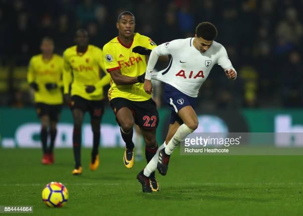 Dele Alli of Tottenham Hotspur is challenged by Marvin Zeegelaar of Watford during the Premier League match between Watford and Tottenham Hotspur at...