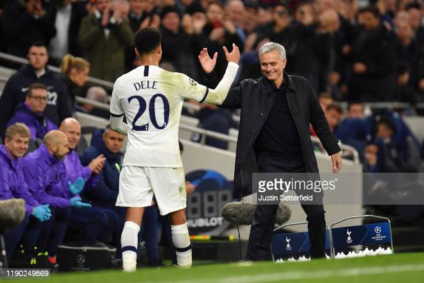 Dele Alli of Tottenham Hotspur is congratulated by Jose Mourinho Manager of Tottenham Hotspur as he leaves the pitch during the UEFA Champions League...