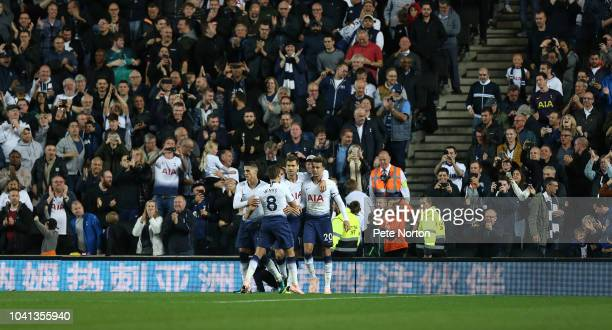 Dele Alli of Tottenham Hotspur is congratulated by team mares after scoring his sides first goal from the penalty spot during the Carabao Cup Third...