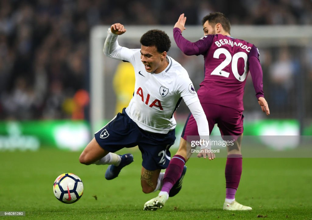 Dele Alli of Tottenham Hotspur is fouled by Bernardo Silva of Manchester City during the Premier League match between Tottenham Hotspur and Manchester City at Wembley Stadium on April 14, 2018 in London, England.