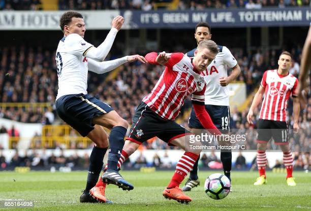 Dele Alli of Tottenham Hotspur is fouled by Steven Davis of Southampton which leads to a penalty for Tottenham Hotspur during the Premier League...