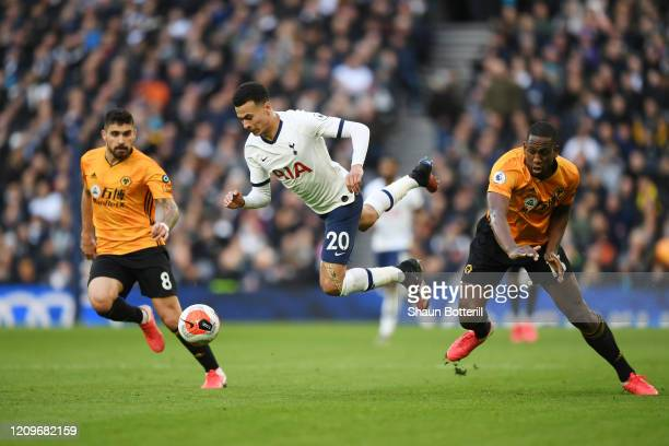 Dele Alli of Tottenham Hotspur is fouled by Willy Boly of Wolverhampton Wanderers during the Premier League match between Tottenham Hotspur and...