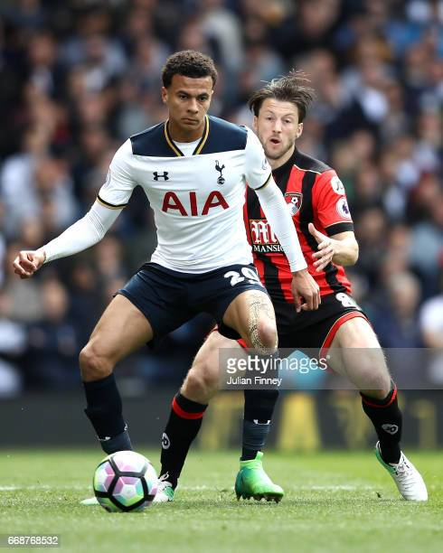 Dele Alli of Tottenham Hotspur is put under pressure from Harry Arter of AFC Bournemouth during the Premier League match between Tottenham Hotspur...