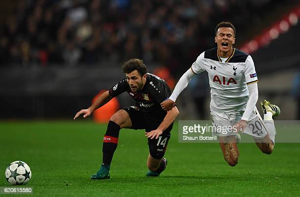 Dele Alli of Tottenham Hotspur is tackled by Admir Mehmedi of Bayer Leverkusen during the UEFA Champions League Group E match between Tottenham...