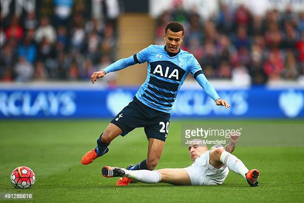 Dele Alli of Tottenham Hotspur is tackled by Jonjo Shelvey of Swansea City during the Barclays Premier League match between Swansea City and...