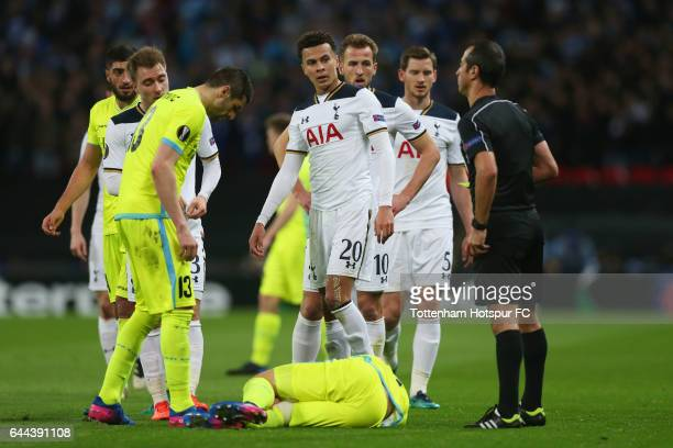 Dele Alli of Tottenham Hotspur looks at referee Manuel De Sousa as he is sent off after a foul on Brecht Dejaegere of Gent during the UEFA Europa...