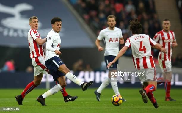 Dele Alli of Tottenham Hotspur passes the ball during the Premier League match between Tottenham Hotspur and Stoke City at Wembley Stadium on...