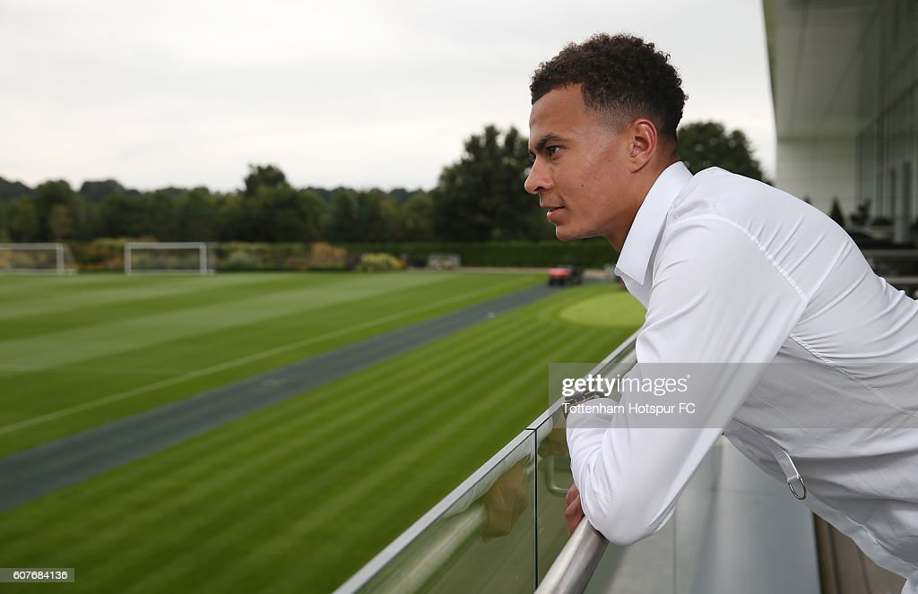 Dele Alli of Tottenham Hotspur poses after signing a new contract on September 6, 2016 in Enfield, England.