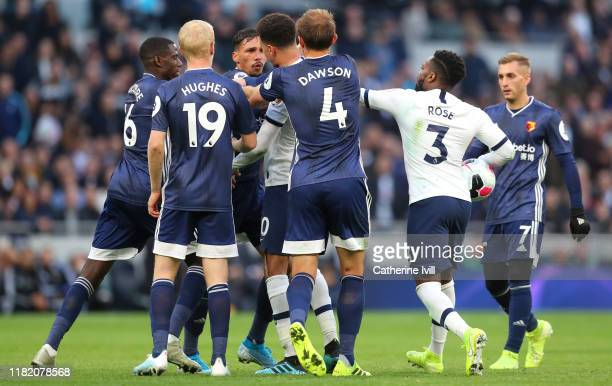 Dele Alli of Tottenham Hotspur pushes and shoves with Jose Holebas of Watford during the Premier League match between Tottenham Hotspur and Watford...