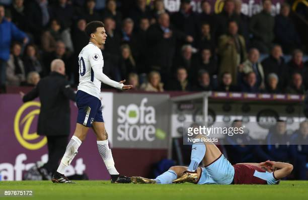 Dele Alli of Tottenham Hotspur reacts after a tackle on Charlie Tylor of Burnley during the Premier League match between Burnley and Tottenham...