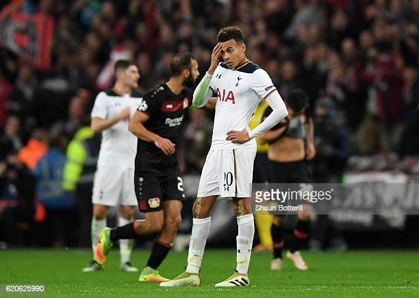 Dele Alli of Tottenham Hotspur reacts after Bayer Leverkusen score their first goal during the UEFA Champions League Group E match between Tottenham...