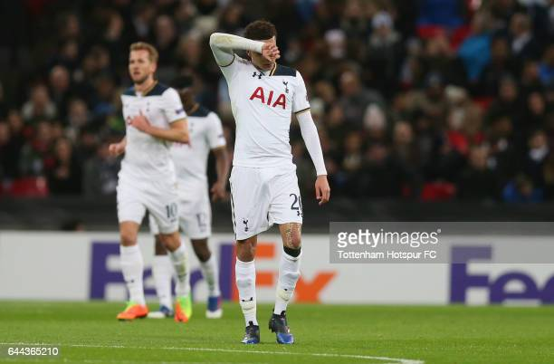 Dele Alli of Tottenham Hotspur reacts as Harry Kane of Tottenham Hotspur scores an own goal for Gent's first during the UEFA Europa League Round of...