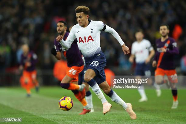 Dele Alli of Tottenham Hotspur runs with the ball during the Premier League match between Tottenham Hotspur and Manchester City at Wembley Stadium on...