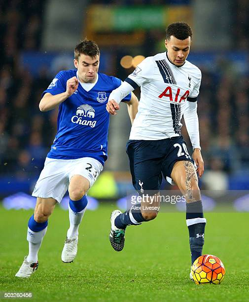 Dele Alli of Tottenham Hotspur runs with the ball under pressure from Seamus Coleman of Everton during the Barclays Premier League match between...