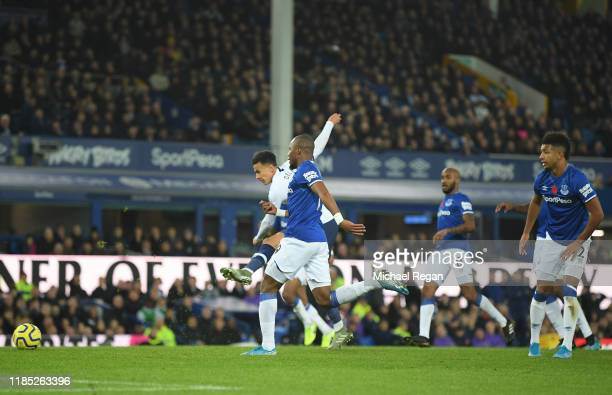 Dele Alli of Tottenham Hotspur scores his sides first goal during the Premier League match between Everton FC and Tottenham Hotspur at Goodison Park...
