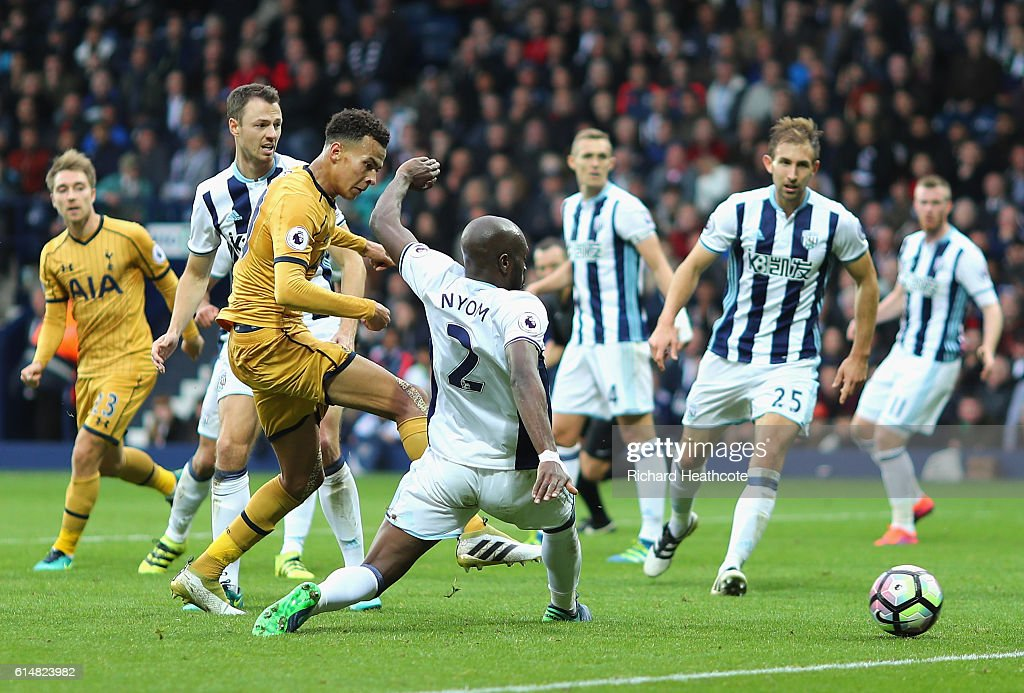Dele Alli of Tottenham Hotspur (L) scores his sides first goal during the Premier League match between West Bromwich Albion and Tottenham Hotspur at The Hawthorns on October 15, 2016 in West Bromwich, England.