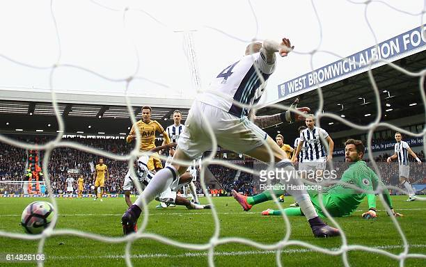 Dele Alli of Tottenham Hotspur scores his sides first goal during the Premier League match between West Bromwich Albion and Tottenham Hotspur at The...