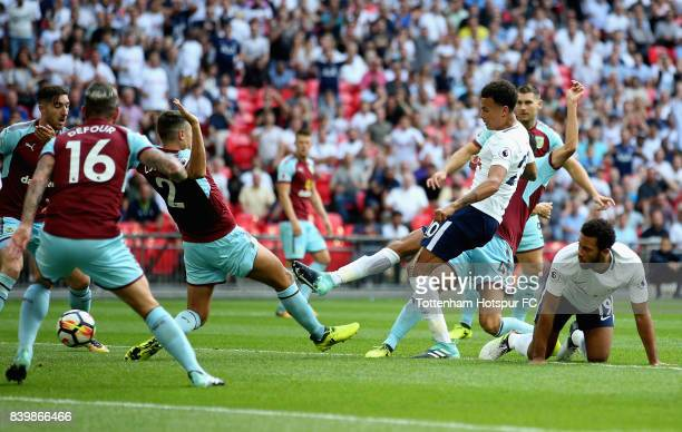 Dele Alli of Tottenham Hotspur scores his sides first goal during the Premier League match between Tottenham Hotspur and Burnley at Wembley Stadium...