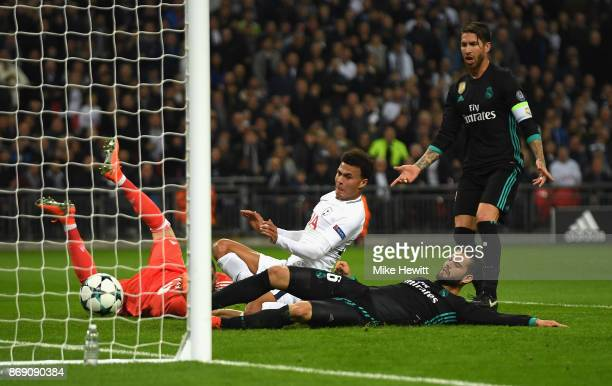 Dele Alli of Tottenham Hotspur scores his side's first goal during the UEFA Champions League group H match between Tottenham Hotspur and Real Madrid...