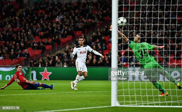 Dele Alli of Tottenham Hotspur scores his sides first goal past Igor Akinfeev of CSKA Moscow during the UEFA Champions League Group E match between...