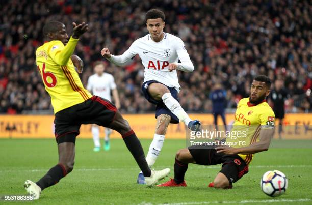 Dele Alli of Tottenham Hotspur scores his sides first goal while under pressure from Abdoulaye Doucoure of Watford and Adrian Mariappa of Watford...
