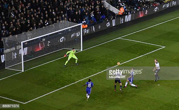 Dele Alli of Tottenham Hotspur scores his sides first goal with a header during the Premier League match between Tottenham Hotspur and Chelsea at...