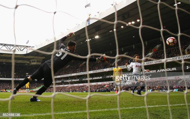 Dele Alli of Tottenham Hotspur scores his sides fourth goal past Tom King of Millwall during The Emirates FA Cup QuarterFinal match between Tottenham...