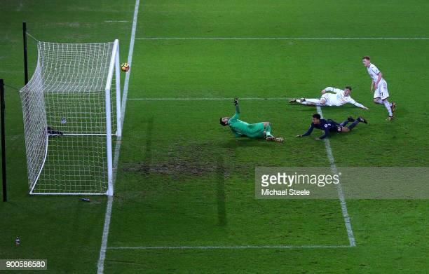 Dele Alli of Tottenham Hotspur scores his sides second goal past Lukasz Fabianski of Swansea City during the Premier League match between Swansea...
