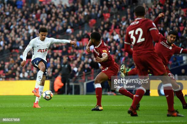 Dele Alli of Tottenham Hotspur scores his sides third goal during the Premier League match between Tottenham Hotspur and Liverpool at Wembley Stadium...