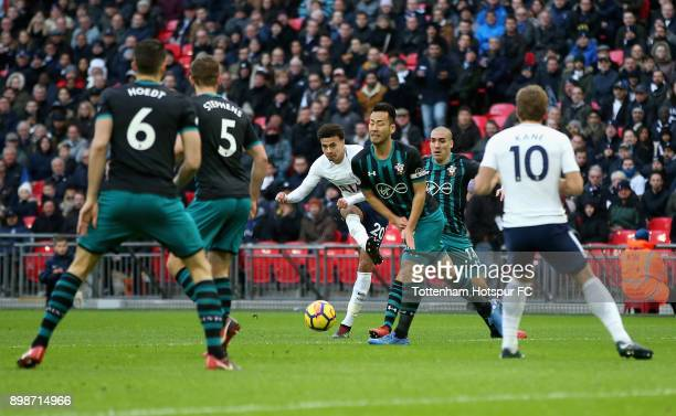 Dele Alli of Tottenham Hotspur scores his sides third goal during the Premier League match between Tottenham Hotspur and Southampton at Wembley...