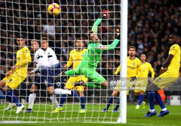 Dele Alli of Tottenham Hotspur scores his teams first goal during the Premier League match between Tottenham Hotspur and Chelsea FC at Wembley...